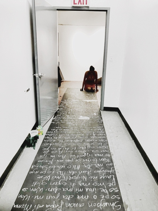 Erasure in Motion, 2017 [Documentation of performance].Performance and installation. Black paint and chalk.4 FT x 14 FT